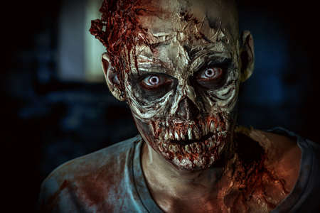 spooky eyes: Close-up portrait of a horrible scary zombie man. Horror. Halloween. Stock Photo
