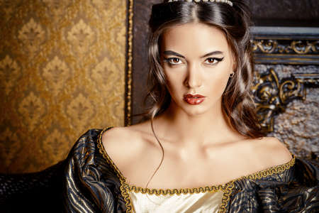 the renaissance: Renaissance Style -  beautiful young woman in the lush expensive dress in an old palace interior. Vintage style. Fashion.