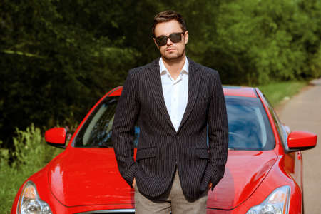 sports day: Handsome young man in his new sports car. Stock Photo
