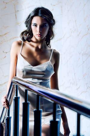 peignoir: Beautiful young woman in elegant evening dress Stock Photo