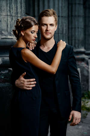 classy: Fashion style photo of a beautiful couple over city background. Stock Photo