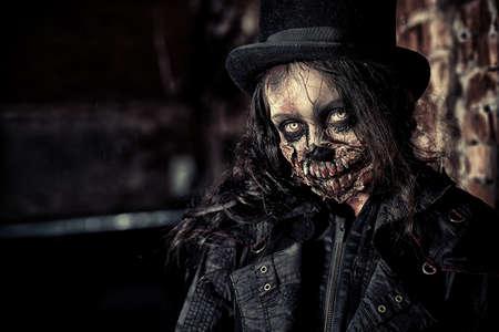 Scary zombie girl standing outdoor. Sugar skull. Halloween.