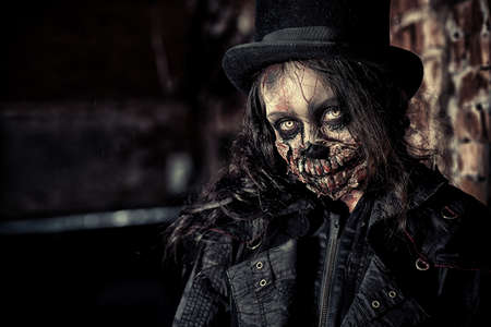 evil girl: Scary zombie girl standing outdoor. Sugar skull. Halloween.
