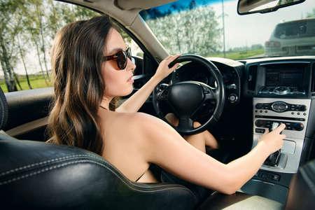 sexy woman car: Beautiful young woman driving her car. Beauty, fashion. Luxurious life.