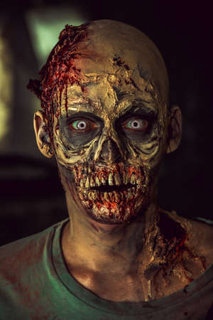 face to face: Close-up portrait of a horrible scary zombie man. Horror. Halloween. Stock Photo