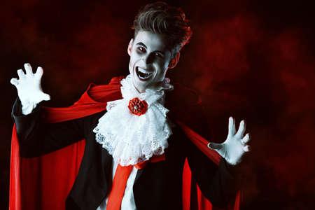beautiful vampire: Handsome bloodthirsty vampire. Halloween. Dracula costume.