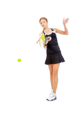 uniforms: Full length portrait of a girl tennis player in motion. Studio shot. Isolated over white.