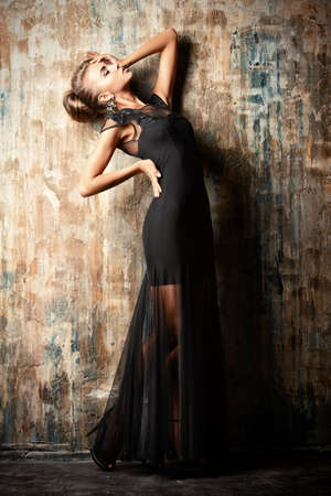Stunning female model in black evening dress.