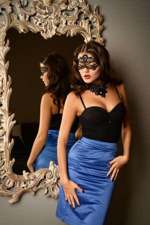 chic woman: Beautiful stranger woman in Venetian mask. Stock Photo