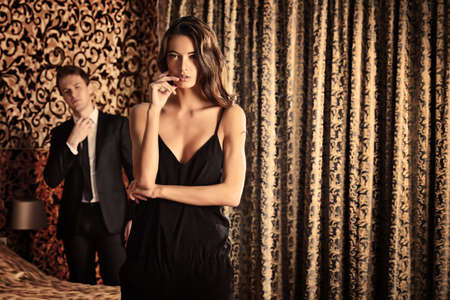 classy: Fashion shot of a beautiful gorgeous couple in a room. Luxury.