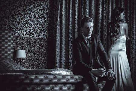 romantic room: Beautiful couple in love in bedroom. Luxury.