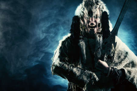animal ritual: Ancient warrior Barbarian. Ethnic costume. Paganism, ritual.