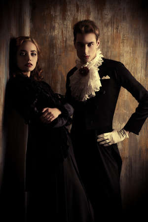 immortal: Beautiful couple of vampires dressed in medieval clothing. Halloween.
