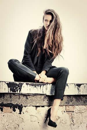 urban fashion: Fashion lady alluring outdoor over urban background.