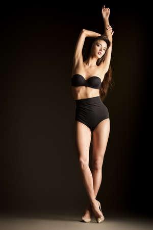 beauty full: Beautiful slender woman alluring in black sexy lingerie. Fashion studio shot. Stock Photo