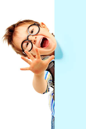 funny glasses: Portrait of a little boy in spectacles with white board. Isolated over white background.