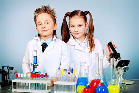chemist: Two children making science experiments. Education.
