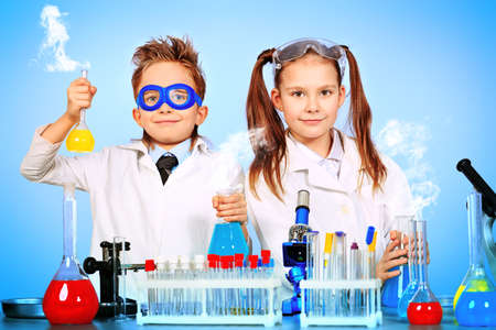 lab test: Two children making science experiments. Education.