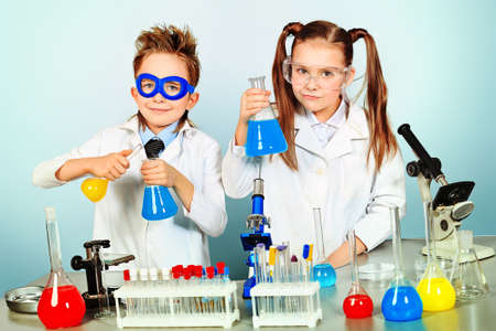 experiment: Two children making science experiments. Education.