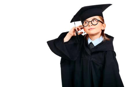 graduacion ni�os: Retrato de un ni�o lindo en un vestido de graduaci�n. Educaci�n. Aislado en blanco.