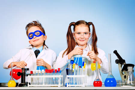 scientists: Two children making science experiments. Education.