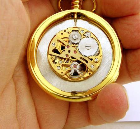Clockwork pocket watch workings macro example in gold photo
