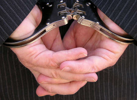 Hands locked securely behind his back Stock Photo - 862858