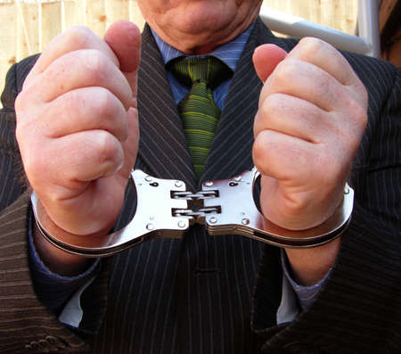 Businessman caught with his hands in the till. Stock Photo - 862860