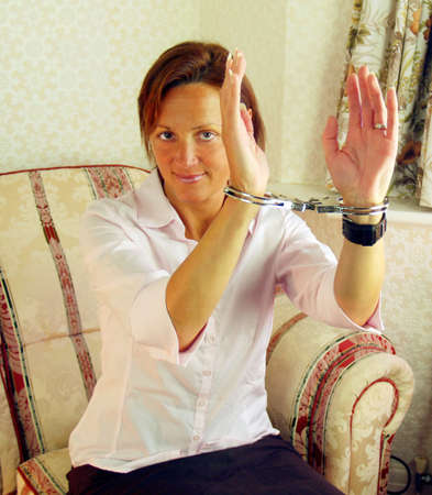 Woman handcuffed and ready for her imprisoner          photo