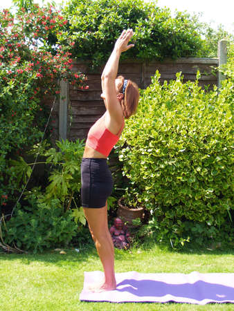 keeping fit: Lady keeping fit outside in the garden