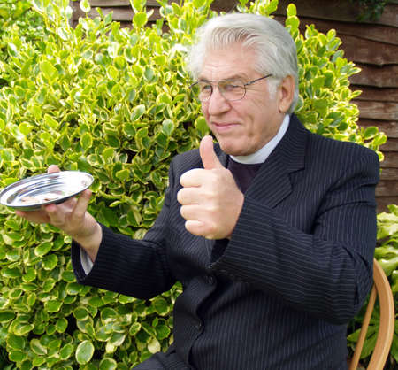 vicar: Vicar passing the plate for you to put in.