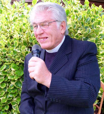 vicar: Vicar giving sermon in the garden of eden