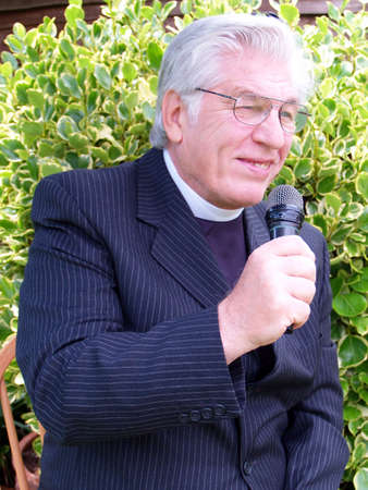 vicar: Vicar in the garden giving a sermon  in spring