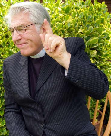 confessor: Vicar giving a sermon in the garden