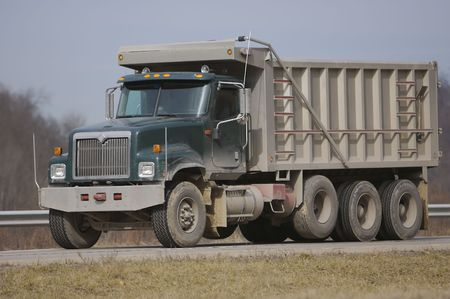 dumps: Dump Truck on the Highway Stock Photo