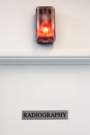 vetinary: Radiography door with illuminated red light above.