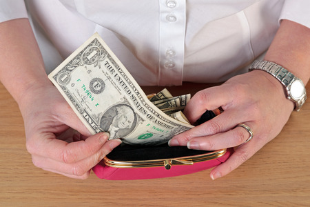Overhead close up photo of a woman taking money out of her purse. Stock Photo - 22647768