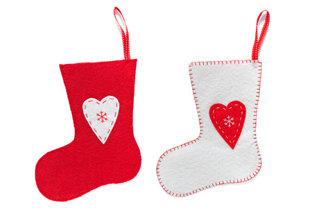 Red and White handmade Christmas stockings isolated on a white background. photo