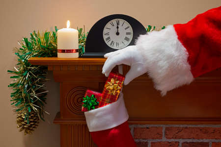 Midnight on Christmas Eve and Santa Claus (or Father Christmas) has come down the chimney to deliver your presents. Stock Photo - 23708239