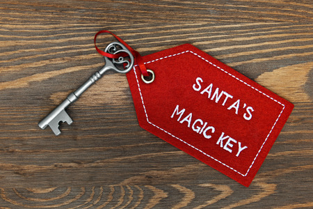 key fob: Santas magic key on a rustic wooden background.