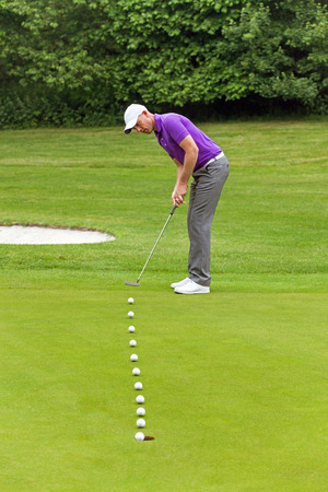 putter: Multiple frame photo of a golfer putting with the line of the ball shown as it travels into the hole.
