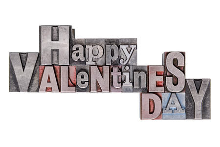 Happy Valentines Day text in old metal letterpress blocks with mixed font, isolated on a white . Stock Photo - 25236761