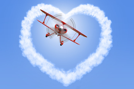 A red biplane creating a heart shaped cloud in a bright blue sky.  photo
