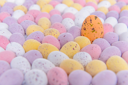 odd one out: Lots of mini candy covered chocolate Easter eggs with one standing out from the crowd.