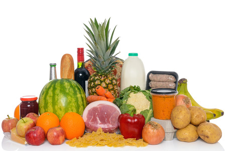 balanced budget: Groceries studio shot of fresh food and drink isolated on a white background, including fruit, vegetables, meat, sauces, pizza, wine and dairy products.