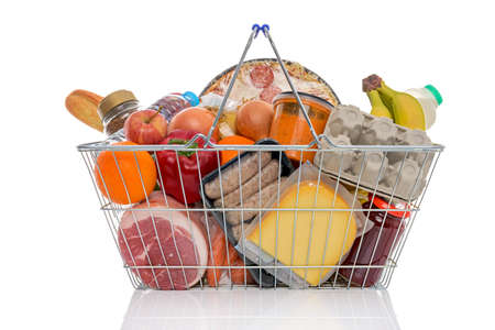 balanced budget: Studio shot of a shopping basket full of food including fresh fruit, vegetables, meat, pizza and dairy products. Isolated on a white background.