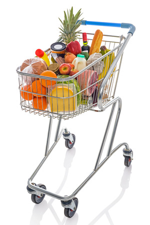 balanced budget: Shopping trolley full of fresh groceries isolated on a white background.