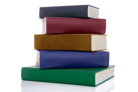 hardback: A stack of five hardback reference books with blank spines isolated on a white background.