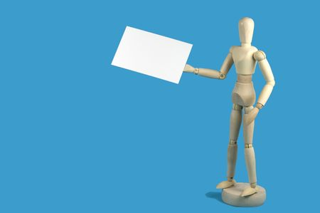 artists mannequin: Wooden artists mannequin holding a blank business card with space for text, sky blue background
