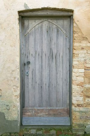 lintel: An old weathered door in part of a derelict 12th century church. Stock Photo